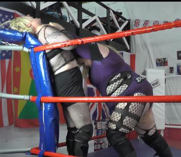 Dominita strangle Rebel in the corner.JP