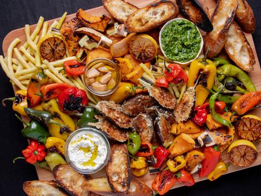 Overloaded Seasonal Antipasto Board Featuring Herb Pesto, Garlic Confit & Fresh Ricotta