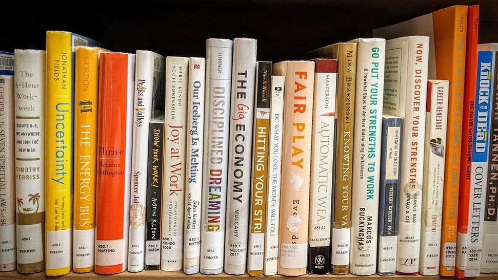 Job opportunites and resume books on a bookshelf