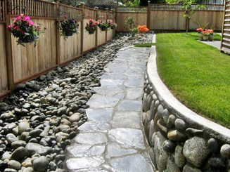 backyard-with-beautiful-river-rocks.jpg