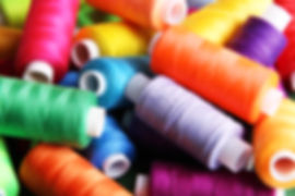 A collection of colorful spools of thread for use in embroidery