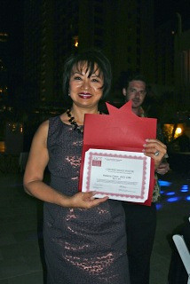 Helena Chenn is the latest CIM. She is pictured here with her certificate, awarded at the 2012 Confe