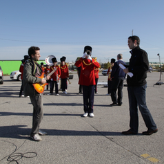 Mike Edgell directing marching band