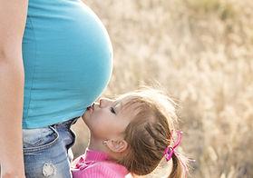 child kissing mum