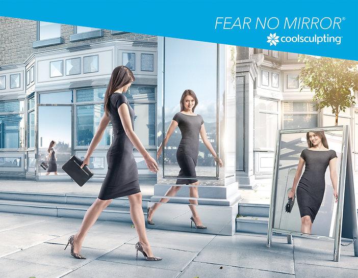 Woman walking in front of mirror.