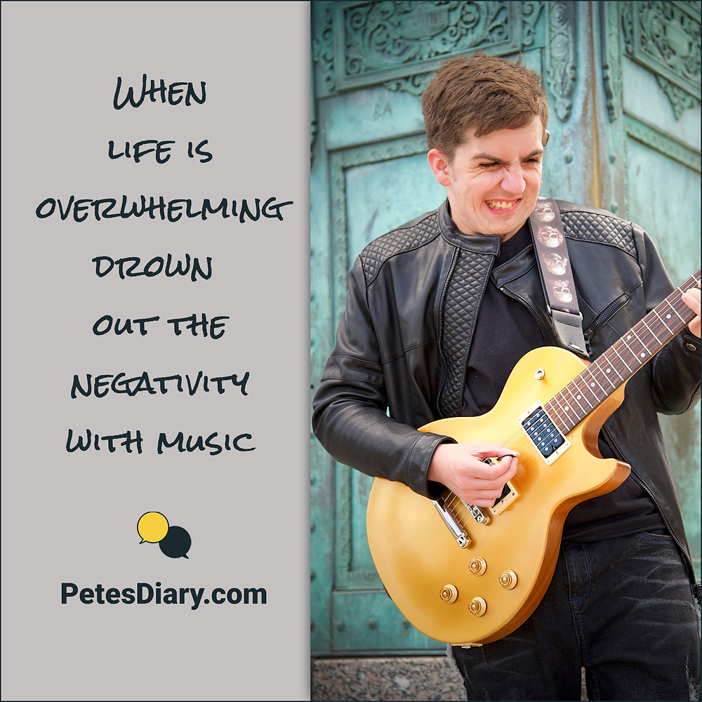 Man in leather jacket with electric guitar and motivational quote
