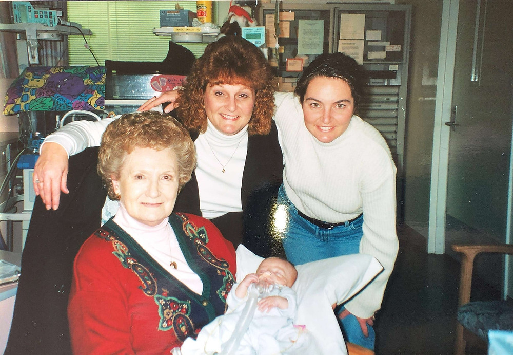 Baby boy in NICU with Mom, Grandma, and Great Grandma