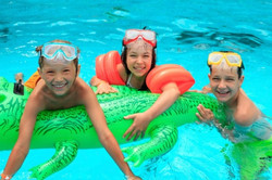 kids swimming in pool with float devices