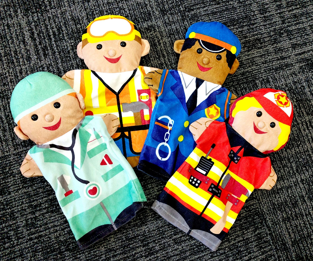 Doctor, construction worker, police officer, and firefighter puppets