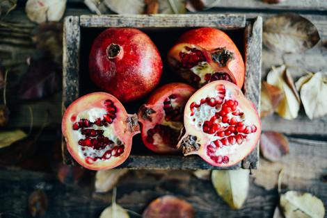 bigstock-Ripe-Pomegranate-Fruit-On-Wood-
