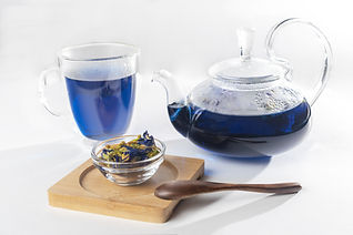 bigstock-Filled-Teapot-And-Glass-Cup-Of-