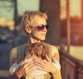 bigstock-Happy-mother-carrying-baby-dau-