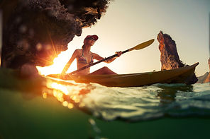 bigstock-Young-lady-paddling-the-kayak--