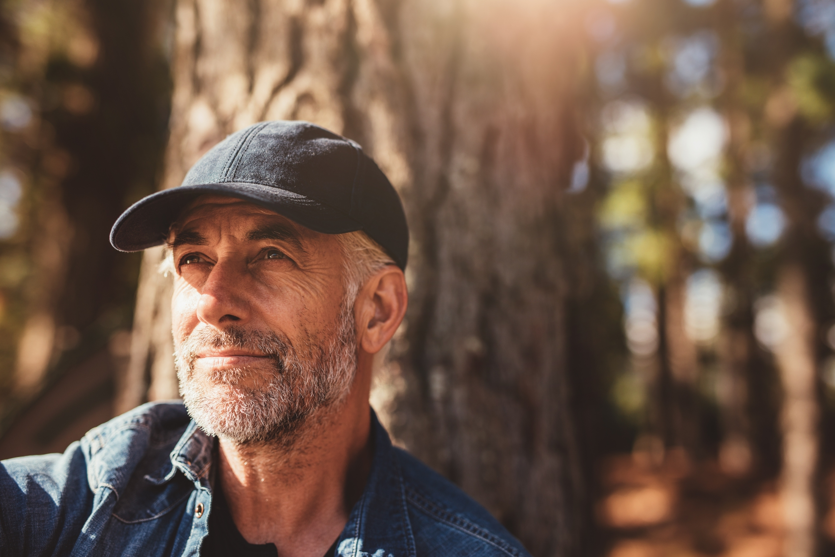 bigstock-Senior-Man-Sitting-In-Woods-On-118997798