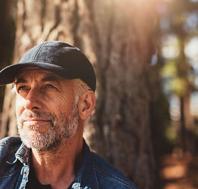 bigstock-Senior-Man-Sitting-In-Woods-On-