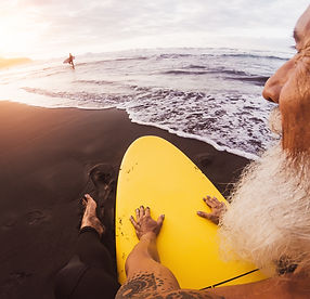 bigstock-Happy-Surfer-Senior-Sitting-On-