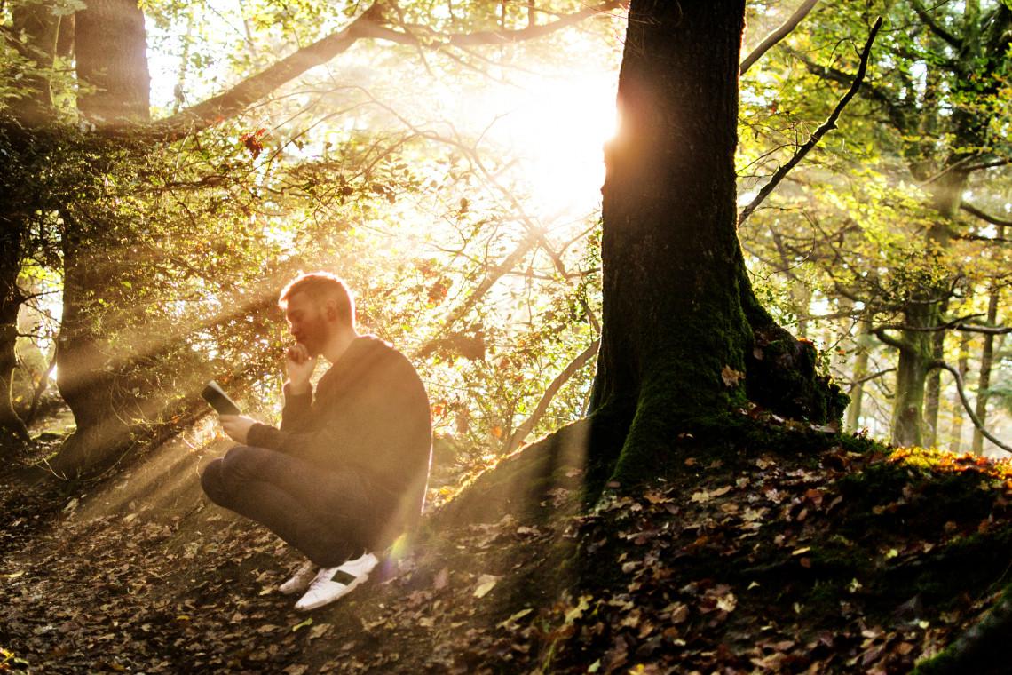 ROP man reading under tree.jpg