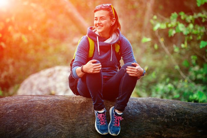 bigstock-Woman-hiker-smiling-standing-o-