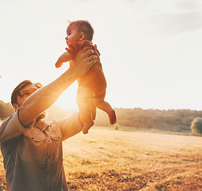 bigstock-Father-Holding-Baby-Up-In-The--