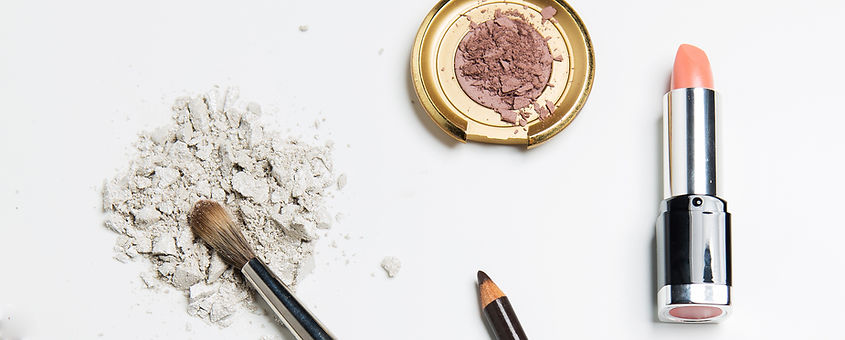 Compact powder and brush for stunning makeup.