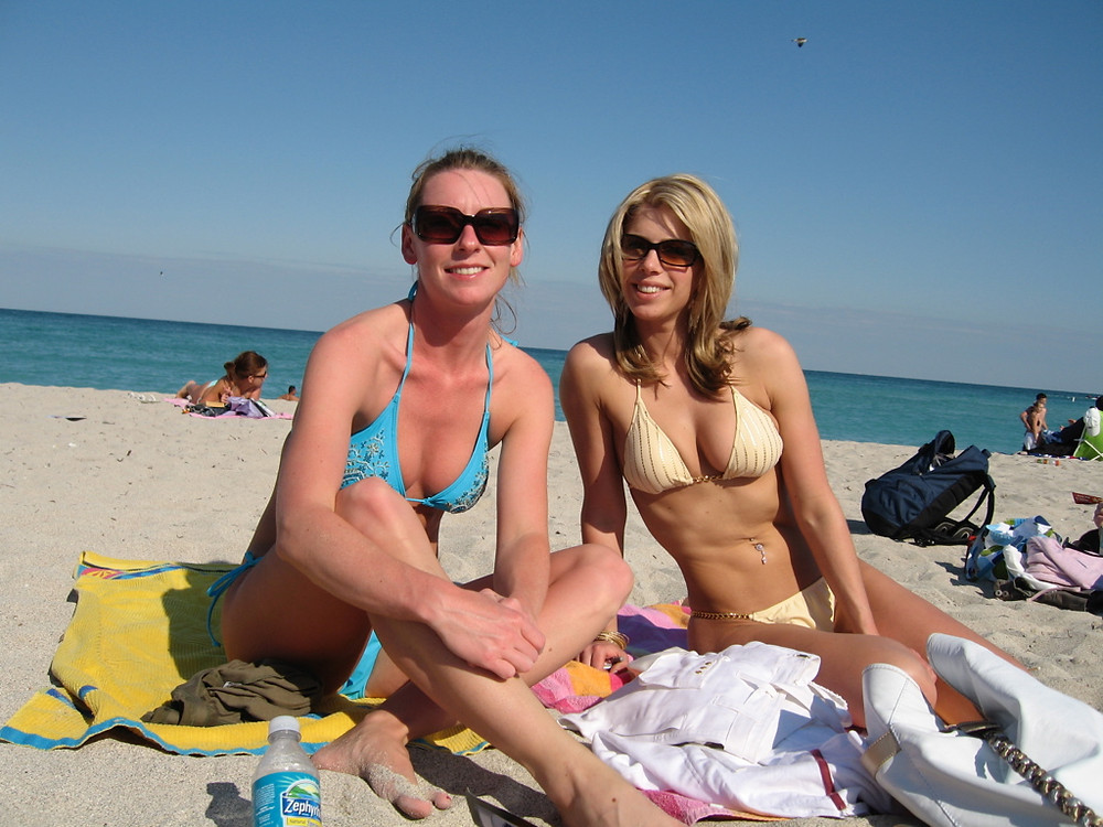 two Canadian women wearing bikinis on the beach in Miami wondering where to buy swimwear online canda