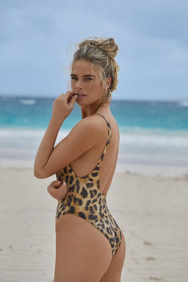A woman from canada is enjoying her vacation in miami wearing a leopard print one piece bathing suit. Shop Leopard Print Swimsuits from sun vixen swimwear which is an online store for designer swimwear