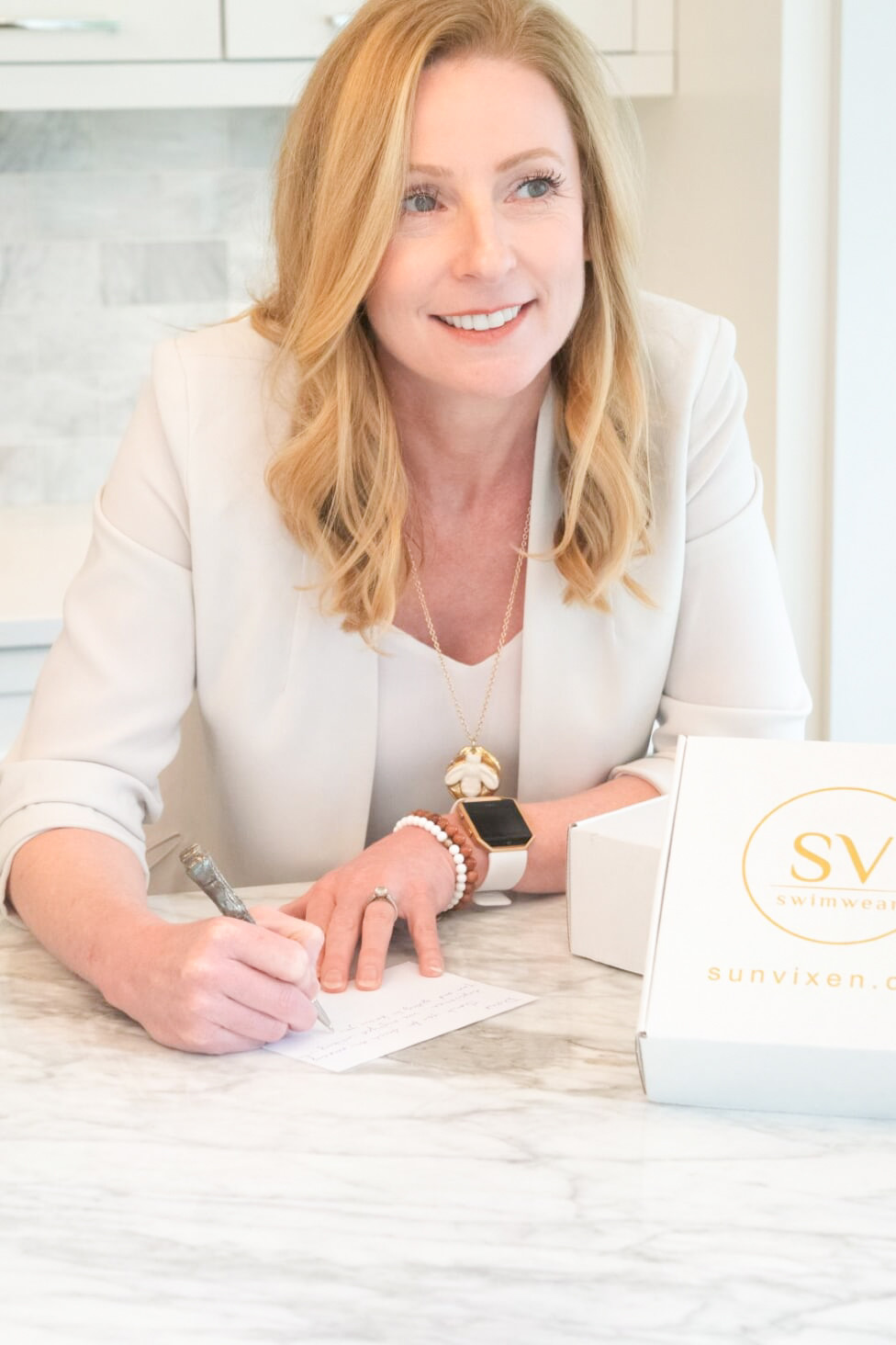 Opal Hurteau of sun vixen swimwear writes a personalized note to her customers who purchase designer swimwear online from sun vixen swimwear in canada