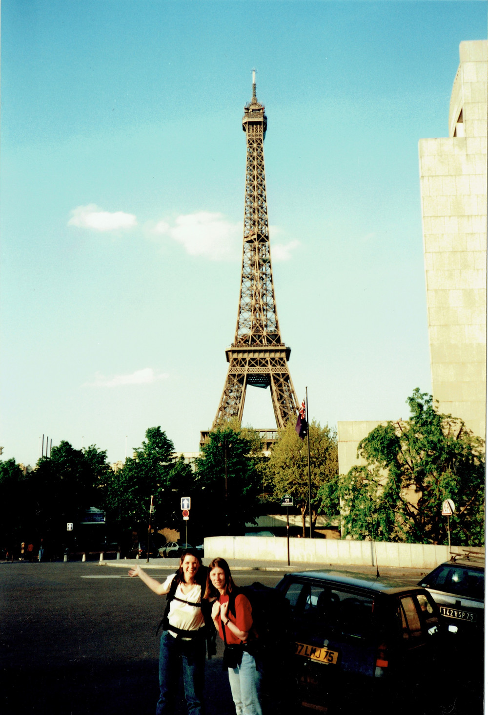 Two Canadian women standing in front of the Eiffel Tower in Paris