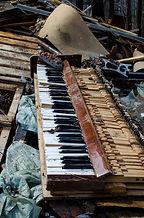 Broken piano, thrown into the trash.jpg