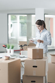 Confident business woman moving in her n