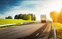 asphalt road on dandelion field with a s