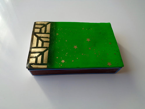 Green matchbox decorated with polymer clay