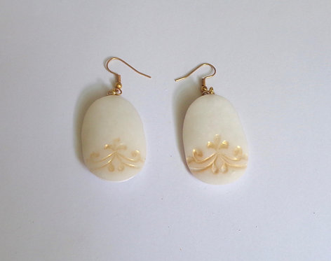 White and gold earrings in polymer clay
