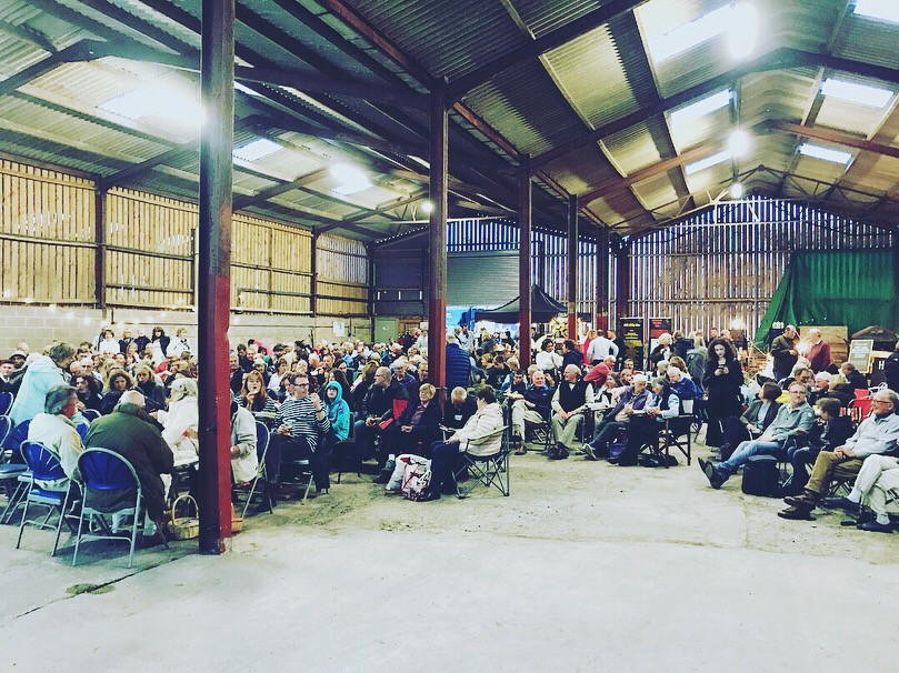 Customers inside barn for Outdoor Cinema