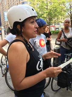 """2018 Fellow Sendy Soto leads a discussion on a bike tour inspired by the book """"Lifting as They Climbed: Mapping a History of Black Women on Chicago's South Side."""""""