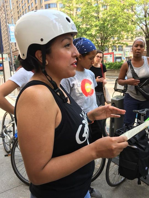 "2018 Fellow Sendy Soto leads a discussion on a bike tour inspired by the book ""Lifting as They Climbed: Mapping a History of Black Women on Chicago's South Side."""