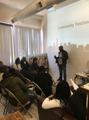 In building community, CUE works to create spaces to share lived experiences, like at this workshop in Englewood where residents speak about the impact of school closings in their lives.