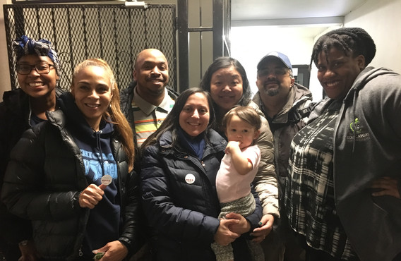 Hyde Parke residents pose for a quick group picture after a Vote Equity party at Sanctuary Cafe.