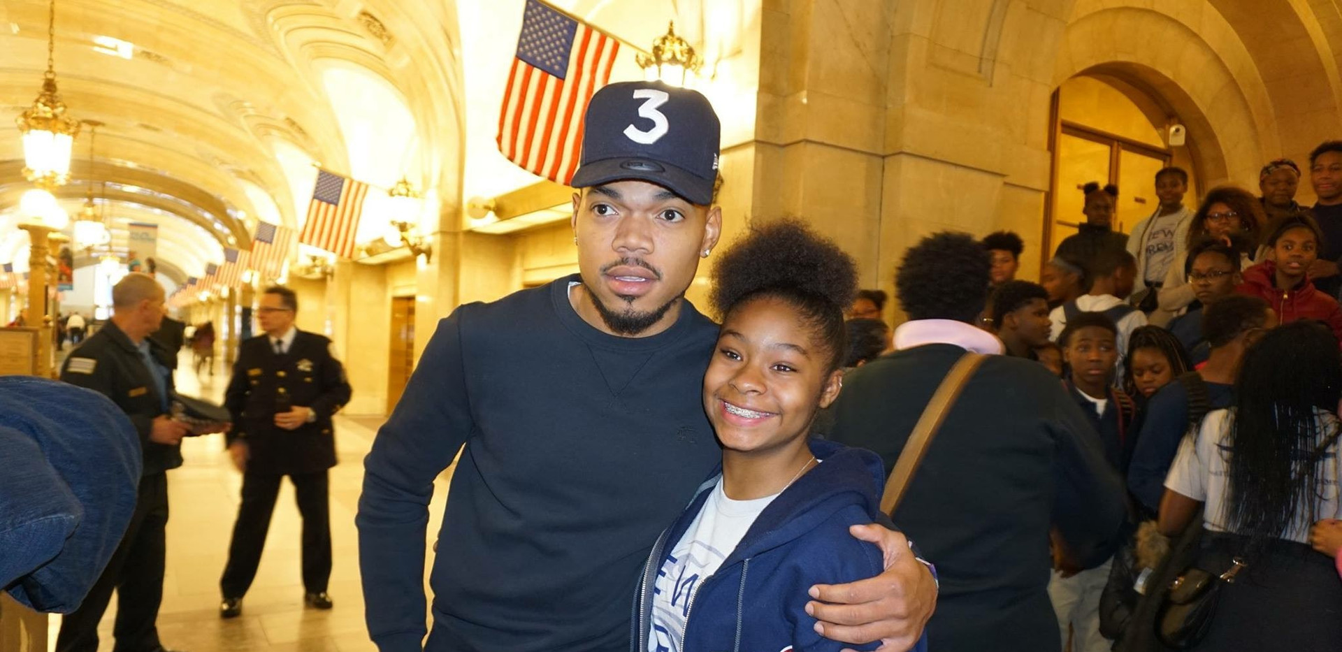 At one of their visits to City Council, students meet Chance the Rapper, seen here with student leader Mariyea Crawford. Crawford served on the Racial Equity Committee for the REIA done on this issue.