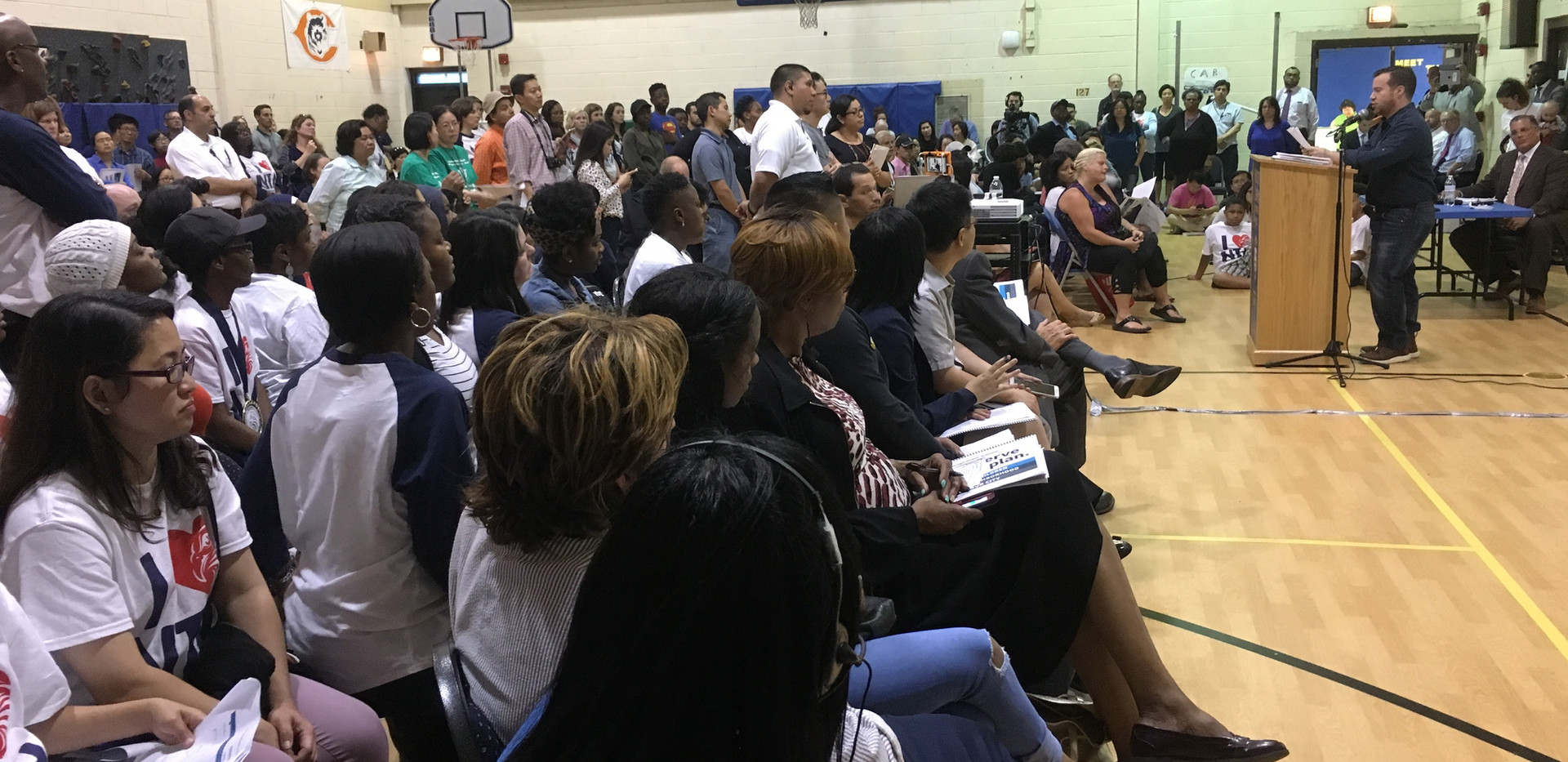 Immediately, Chicago Public Schools began holding community town halls to share proposal details. Here, you can see a long line of speakers waiting for a 2-minute speaking slot to speak for or against the given proposal, in a typical town hall format that severely limits the ability to collaborate or consider other options.