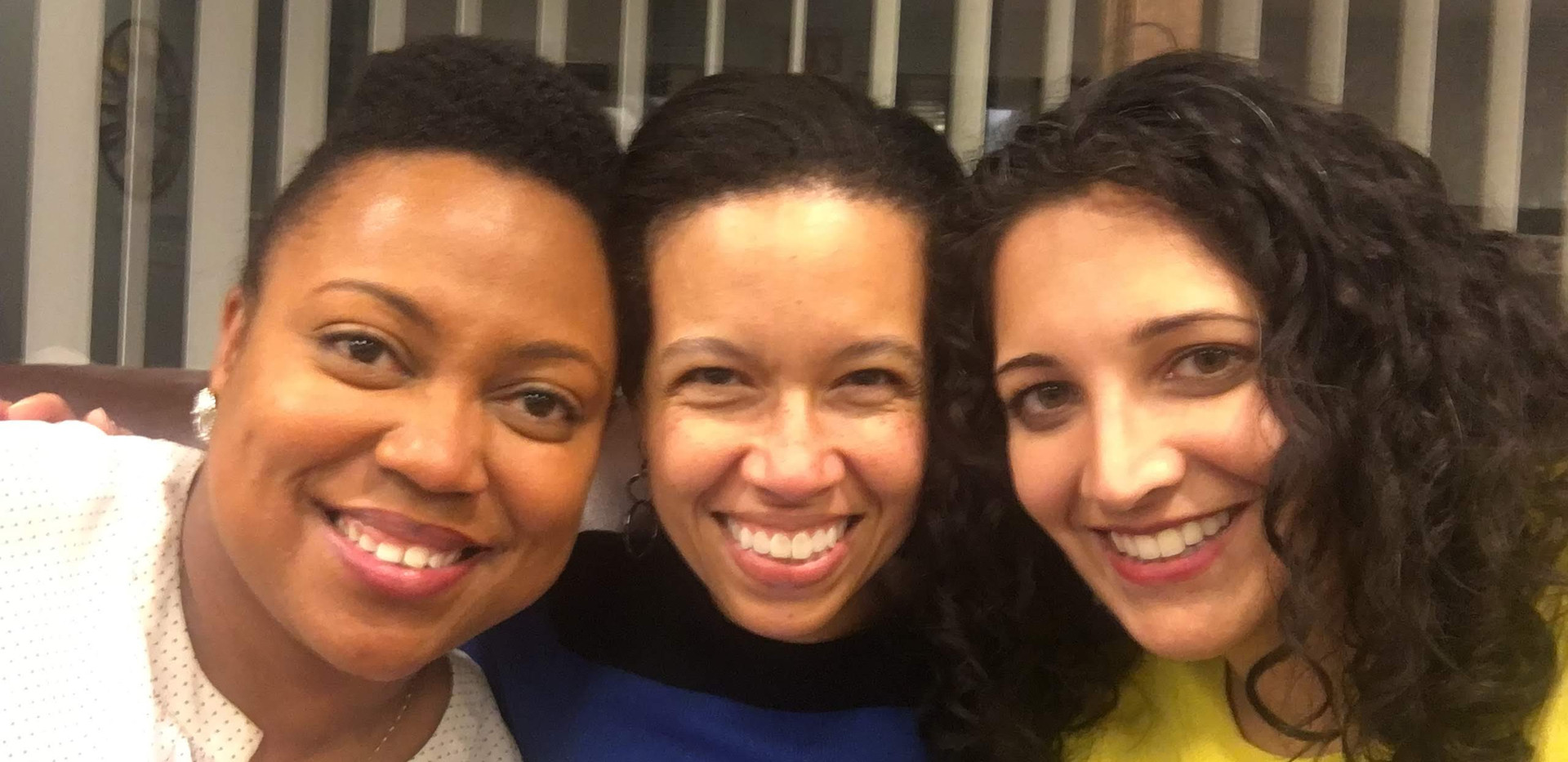 Candace Moore, Elisabeth Greer, and Niketa Brar celebrate the win at the Chicago Lawyers' Committee's law offices on the night of the court decision. Moore went on to become Chicago's first Chief Equity Officer in June 2019 and leads the Office of Equity and Racial Justice for the City of Chicago.