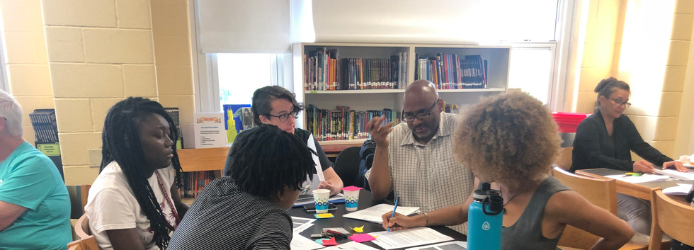 Participants for a REIA 101 Training at National Teachers Academy in July 2019, learning the components of a Racial Equity Impact Assessment.