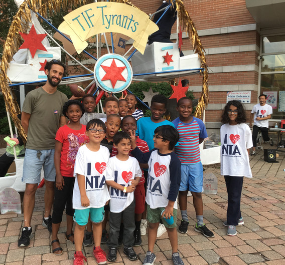 The Ferris Wheel becomes a big hit in bringing community together, seen here at a summer cookout where families from across the NTA community get together.