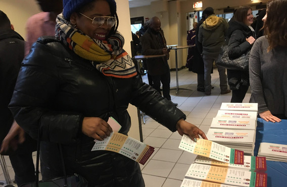 Attendees to candidates' forums took multiple copies of printed voter guides home for friends and neighbors.