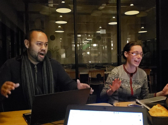 2018 CUE Fellows Adam Slade and Sara Shaw find ways to keep themselves motivated in the late night editing for the final report.