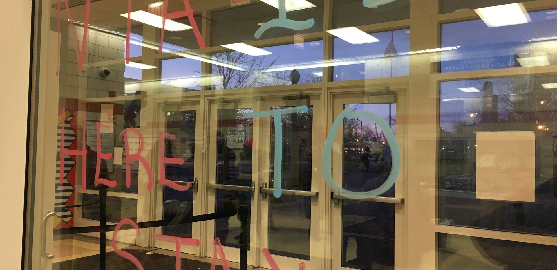 Throughout the campaign, educators do their best to keep students' and families' spirits up. Here, the anxiety of the expected court decision is off-set in artwork throughout the school.