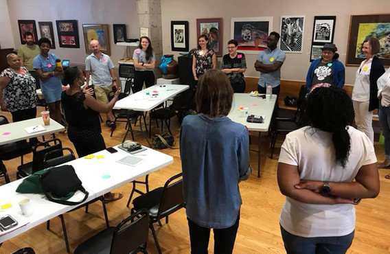 CUE Fellows trained with us over the last two years are working with community residents to prepare for the Racial Equity Impact Assessment process.   Here, 2019 CUE Fellow Tracy Bishop reviews core concepts at a REIA 101 training in Pilsen.