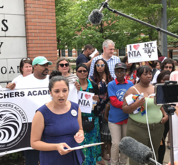 Despite the consistent protest, the Board of Education and City Council approved the school closure action. As a result, NTA families and CUE filed a lawsuit to stop the closure on civil rights grounds. Here, executive director Niketa Brar speaks at a press conference on the last day of school in June 2018.