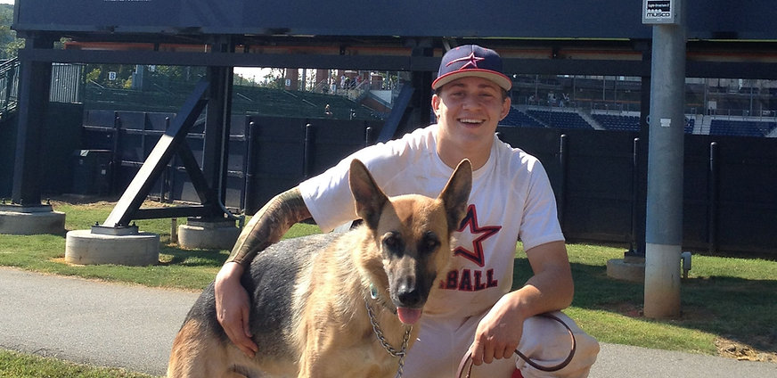 Matt Poyner after Stars Showcase Baseball Tournament Game with his dog Yana.