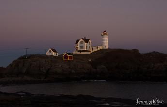Nubble sitting on Island in Lights